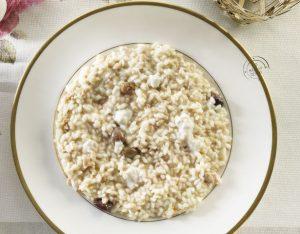 Risotto con ragù bianco di coniglio, olive e burrata
